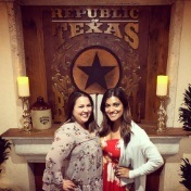 Doctor Pitarra and team member in front of sign reading Republic of Texas
