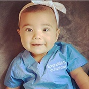 Smiling baby in blue shirt