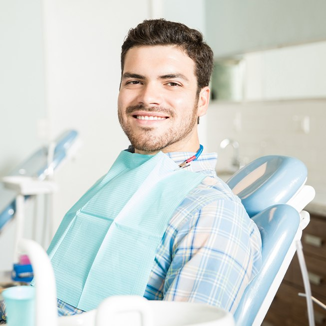 Young man sharing healthy smile after dental checkup and teeth cleaning
